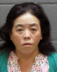 Woman Charged After Drugs  Found in Luggage