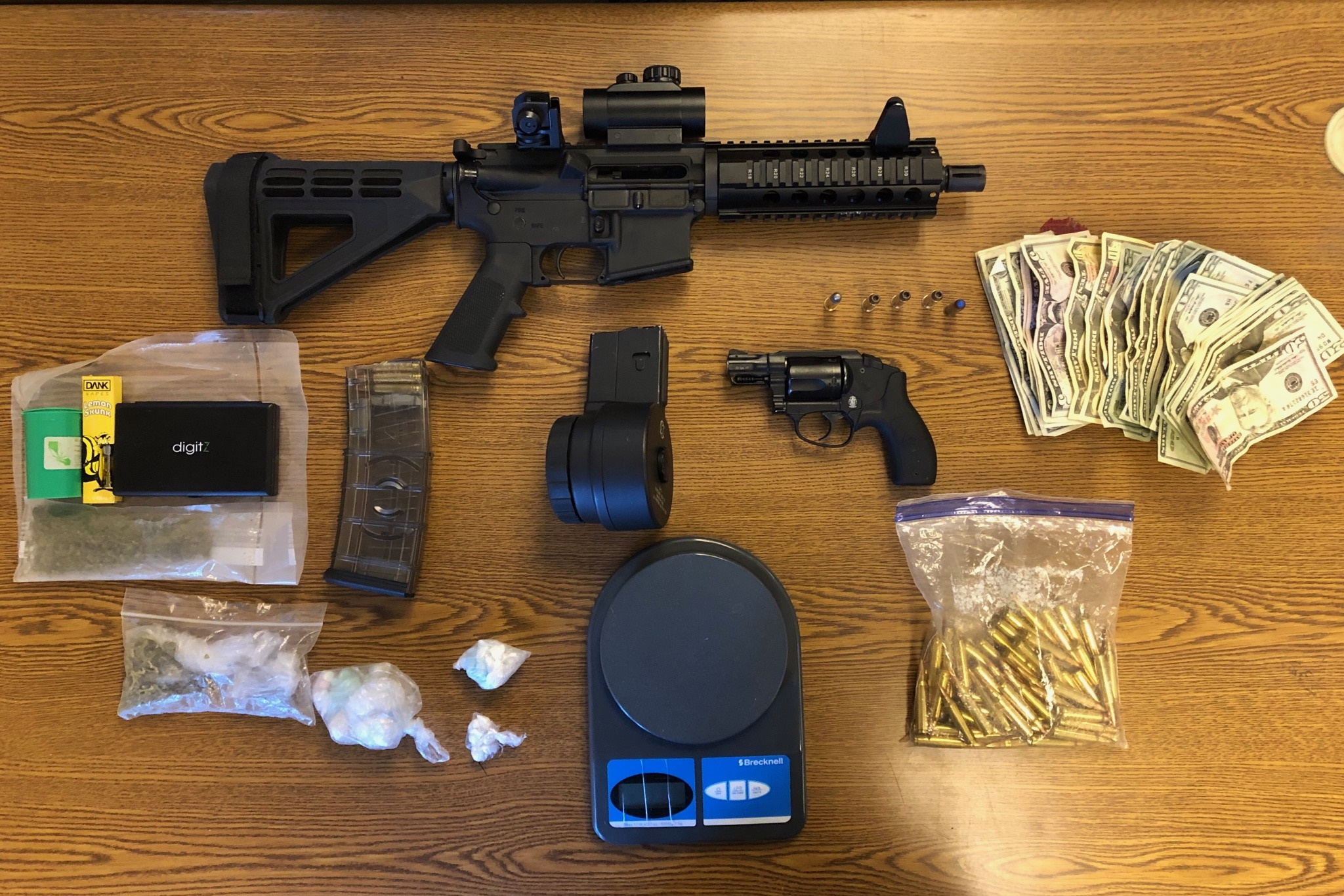 Man Charged with UUW after Firearms, Ammunition Found in Apartment